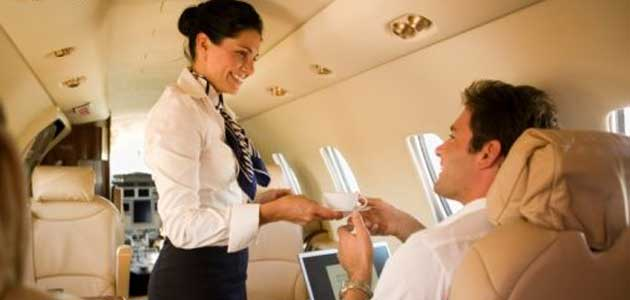 flight attendant serving drink