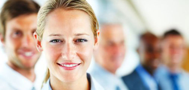 businesswoman smiling with people in the background